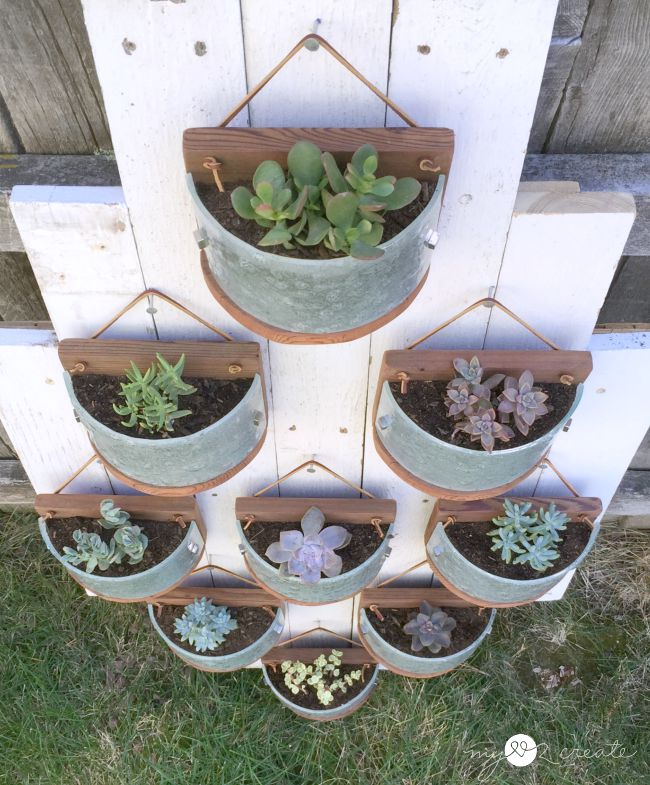 Mylove2Create, Hanging succulent planters made from light fixtures and deck wood