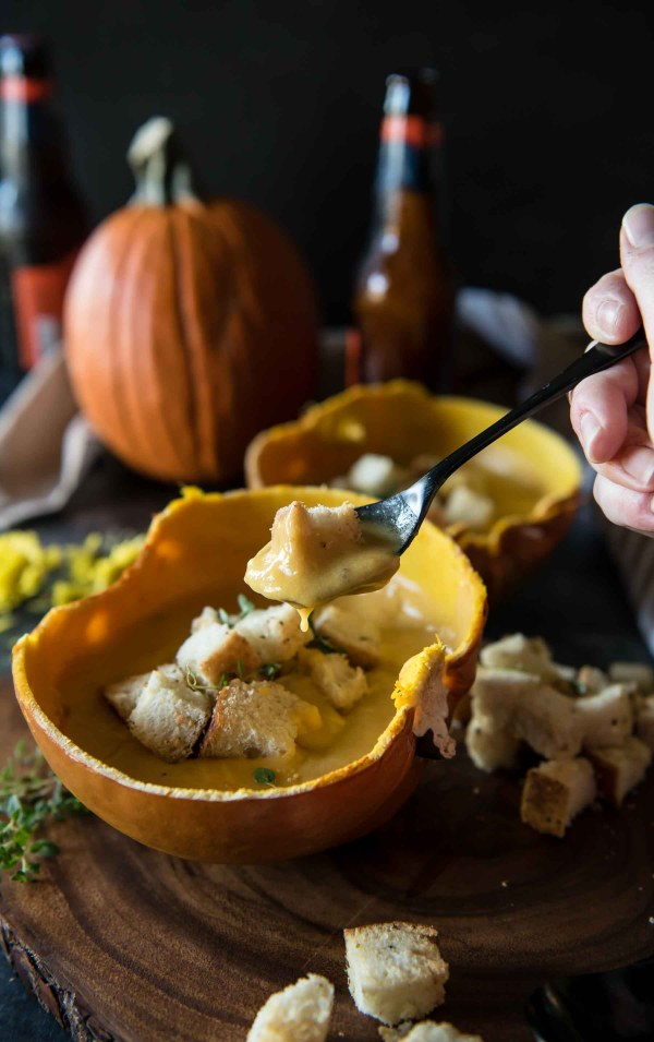 This rich and creamy Pumpkin Beer Cheese Soup gets the seasonal treatment, and the homemade herbed croutons add a happy crunch to this satisfyingly easy meal!