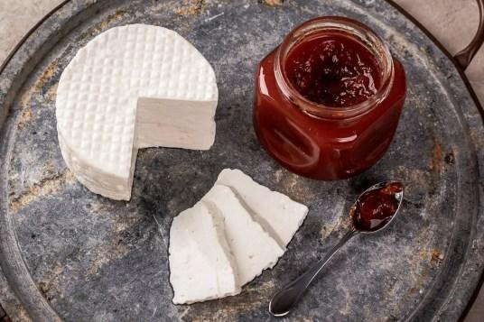 Brazilian dessert Romeo and Juliet, goiabada jam of guava and cheese Minas on gray board. Selective focus
