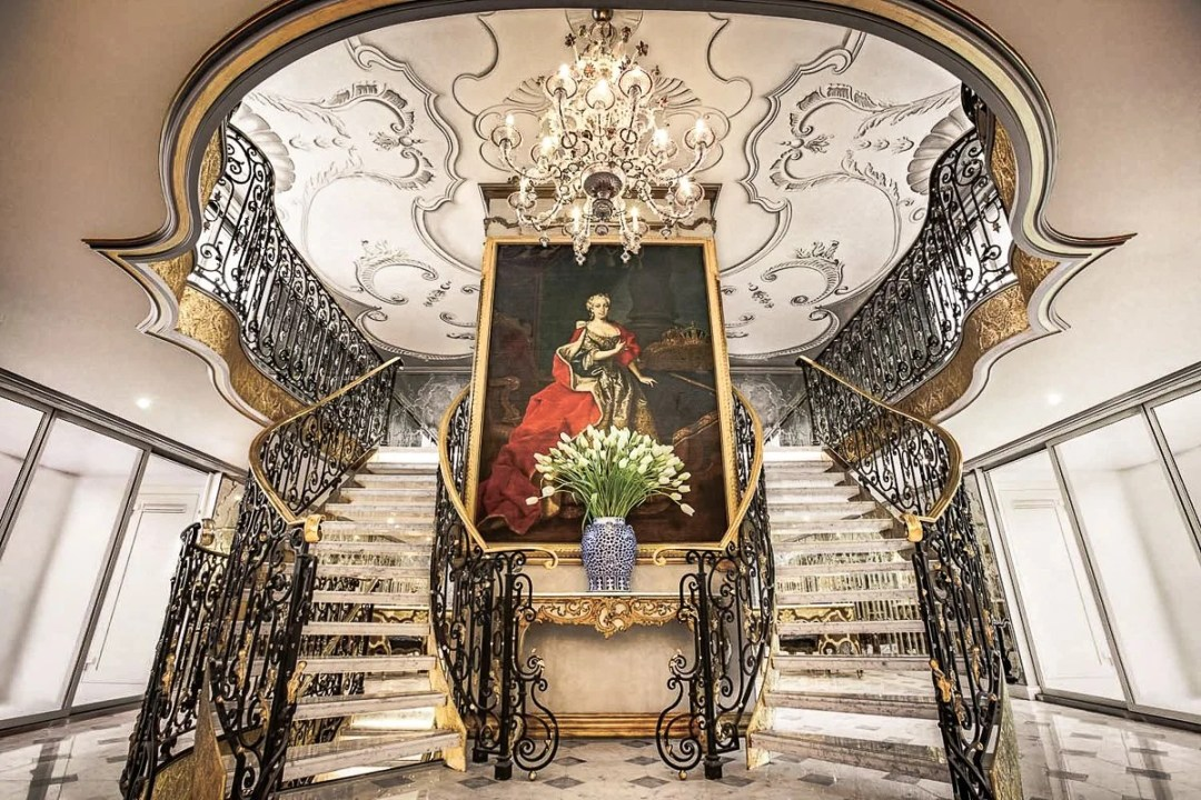 Double staircase and portrait of Maria Theresa on the Uniworld S.S. Maria Theresa river cruise ship