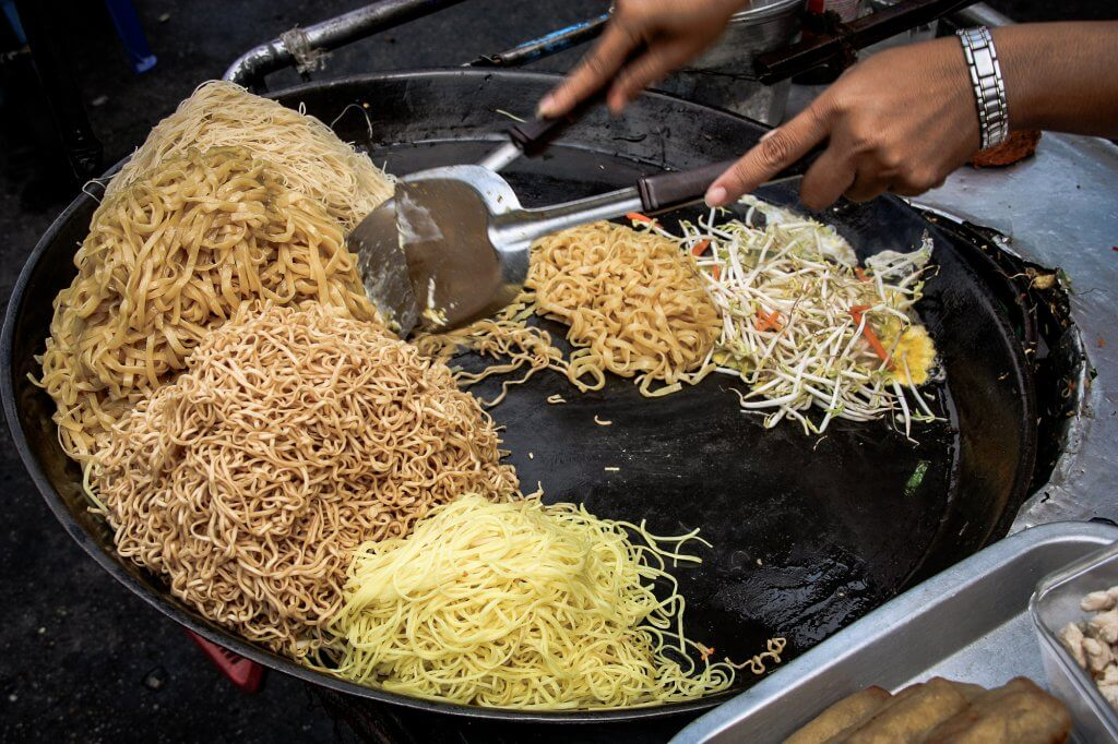 Preparing pad thai at a street hawker mobile restaurant in Bangkok, Thailand. Fried noodle.