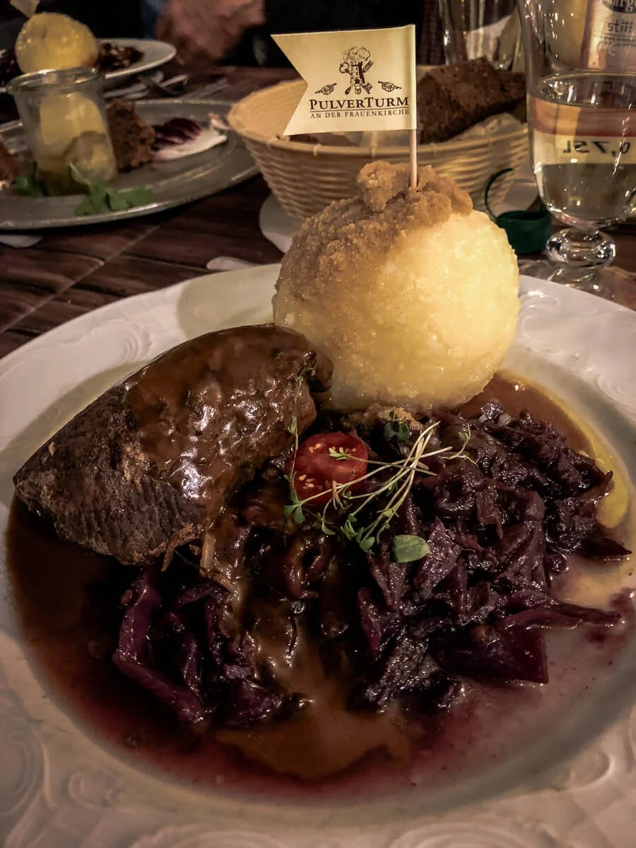 Where to Eat in Dresden: Rinderroulade served a white plate