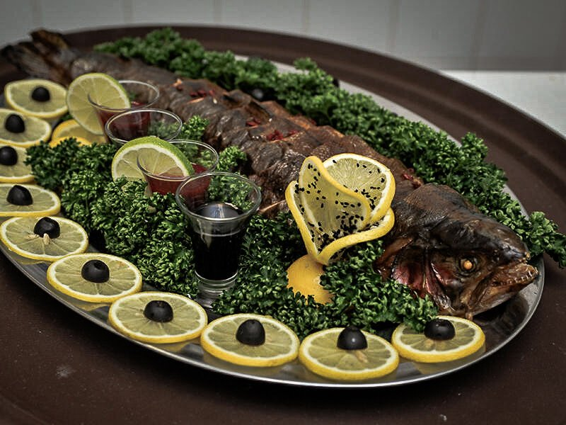 fish levengi on a platter with lemon slices