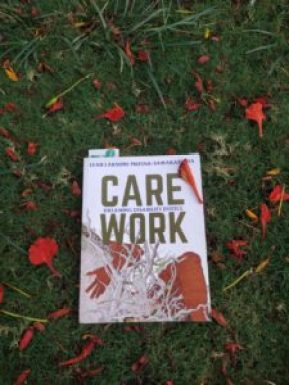 the book care work on the grass with gulmohar leaves all around
