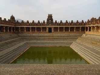 A giant step well against the backdrop of a old architecture