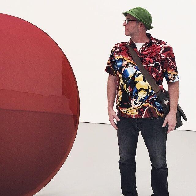 Josh Lowenfels wearing a green hat In Art Gallery