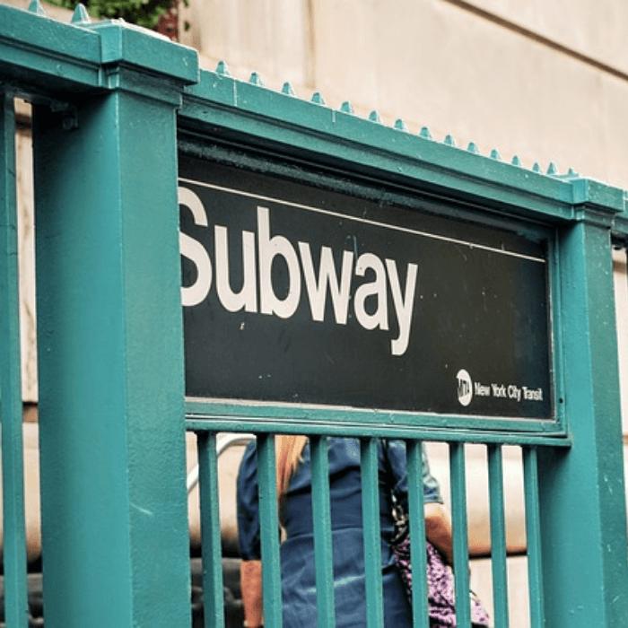 Green metal railing of the NYC Subway Entrance