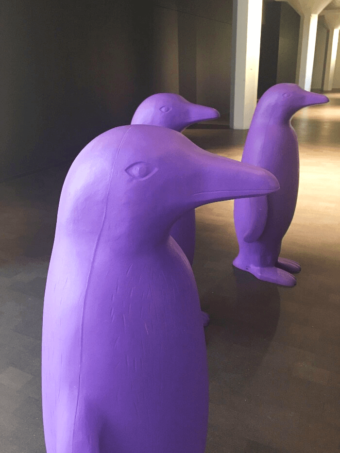 Three purple penguins in a hallway in the 21c Oklahoma City Hotel