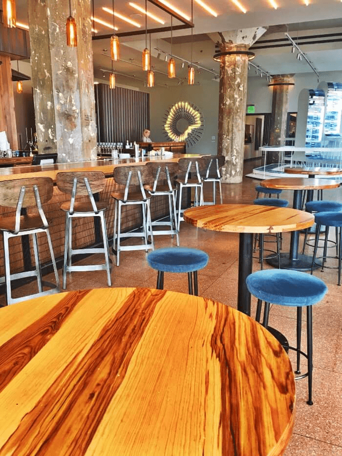 Wood Tables and metal bar stools inside Mary Eddy's Restaurant