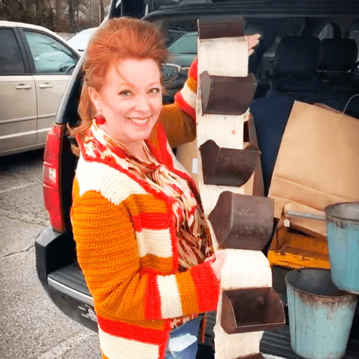 The Curious Cowgirl holding an industrial antique from the Fiddlers Antique Show