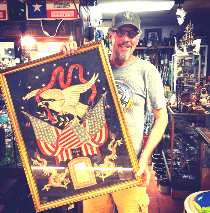 Will Evans with a framed Marine Corps flag