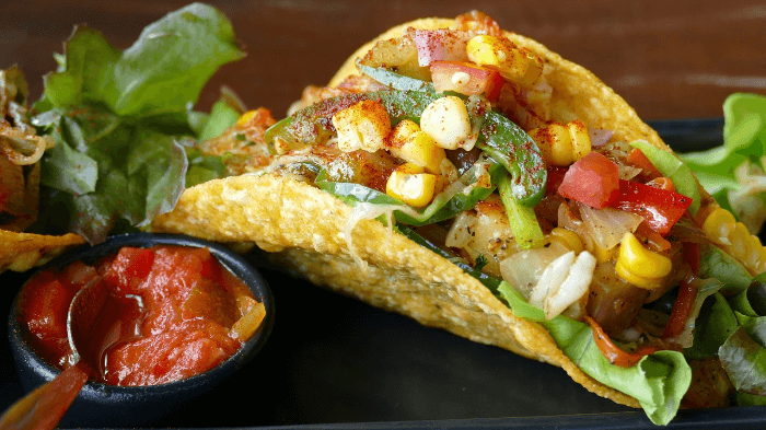 Corn tortilla taco with corn and peppers