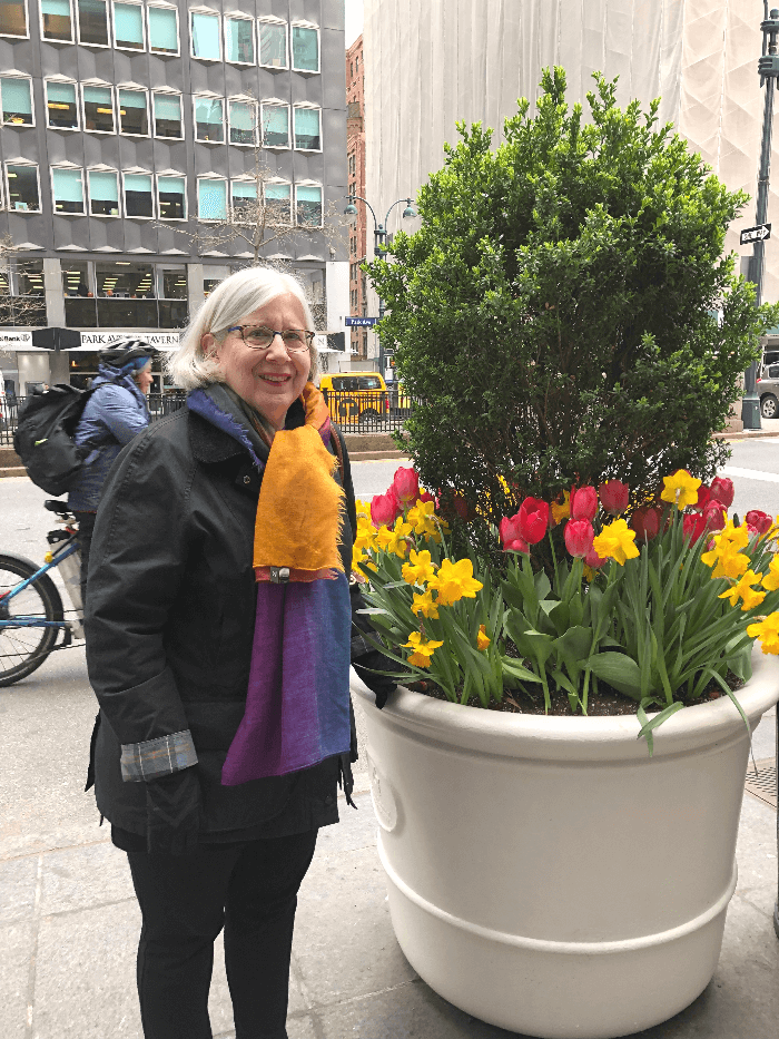 Patricia Sone with planter of flowers in NYC