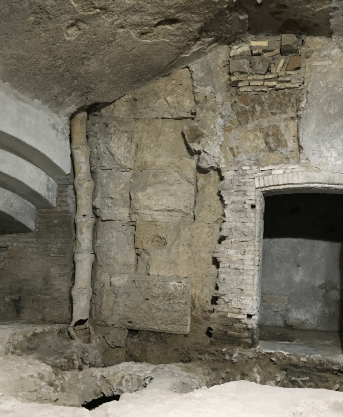 basement room with Roman Ruins in the corner