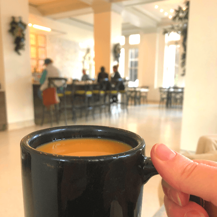 a black mug of coffee at Kitchen No. 324
