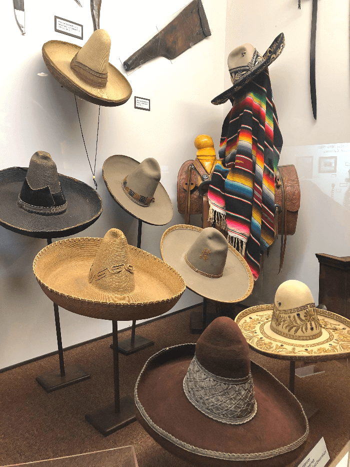 a collection of antique Mexican Sombreros