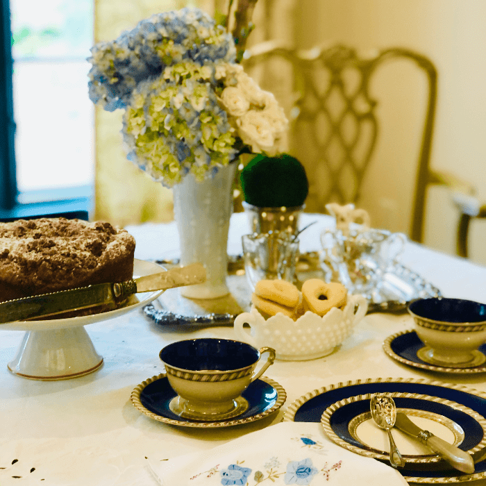 a table set with blue and white china