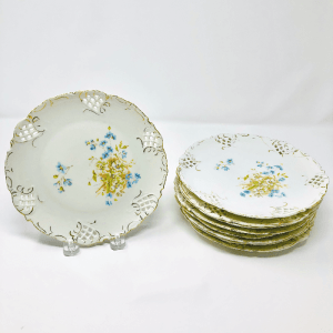 Set of White Fretwork Plates with blue and yellow flowers