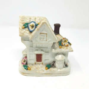 a small white porcelain house