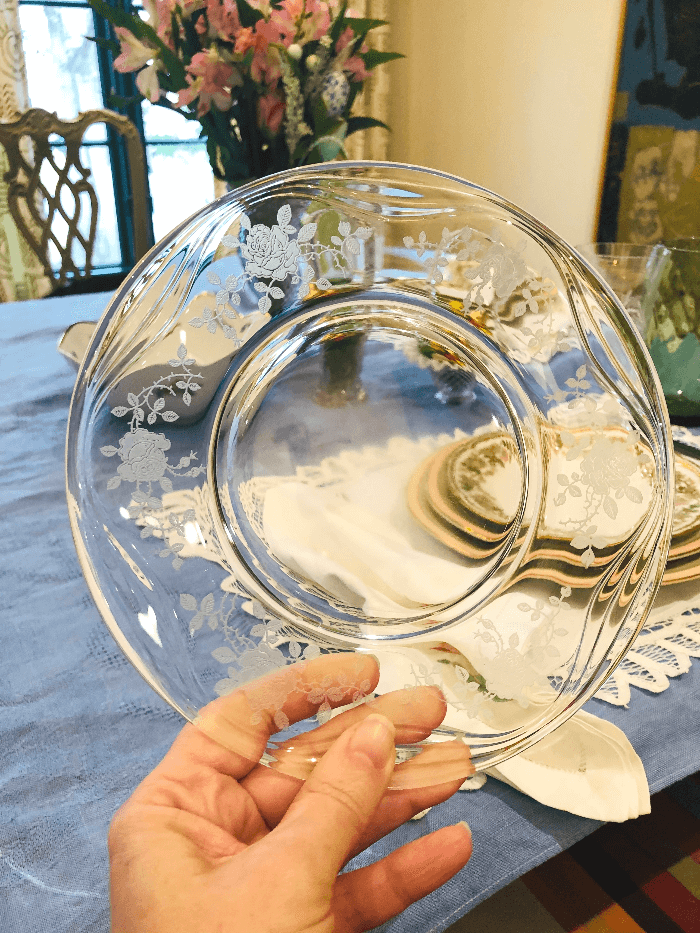 a hand holding a clear etched plates