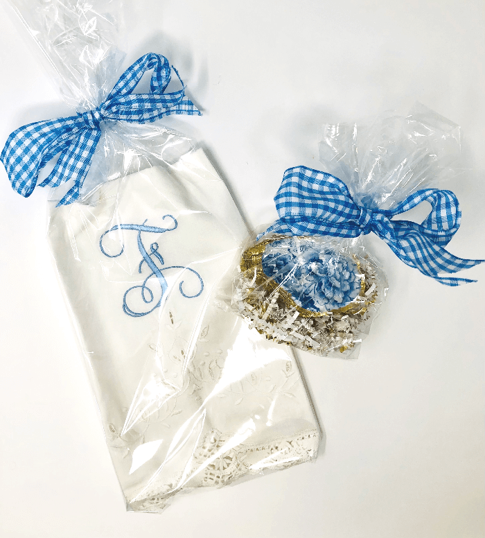 a white towel and an oyster shell dish died with blue bows