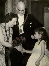 The blog author presenting a bouquet to her Grandparents