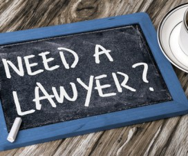 "a tablet with a sign ""need a lawyer?"""