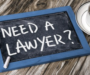 """a tablet with a sign """"need a lawyer?"""""""