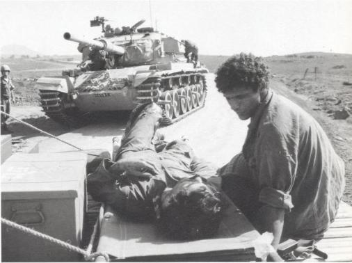 Israeli soldier being evacuated from the Golan front.
