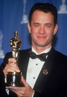 Tom-Hanks-holds-up-the-Oscar-statuette-he-won-for-Best-Actor-for-his-role-in-the-film-Philadelphia