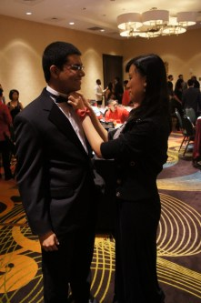 Darnielle Chang adjusts Senator Tanzeem Chowdhury's bow tie. Chowdhury claimed to be wearing an SGA Special Tux Collection; however, the jury is out on whether that exists. | Natalie Harms/The Daily Cougar