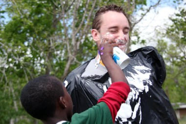 Psychology junior Nathan Colbert fell victim to a can of shaving cream during an activity for children. | Mahnoor Samana/The Daily Cougar