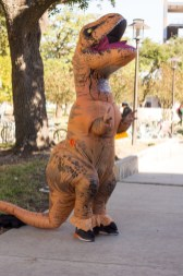 Jose Cordero, civil engineering sophomore, dwarfed inside his giant T-Rex costume. | Katrina Martinez/The Cougar