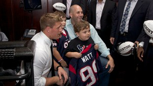 Texans' defensive end J.J. Watt poses with the fan who purchased his autographed jersey.   Fernando Castaldi/ The Daily Cougar