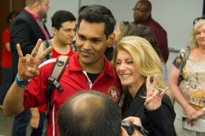 SGA Election Trial Board Chair Yasz Shaikh flashes the Cougar sign with Wendy Davis. | Steven Chambers/The Cougar