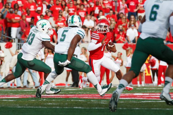 Sophomore quarterback Greg Ward was under duress all afternoon but often found running lanes to the outside, which led to team-highs in attempts (18) and rushing yards (59) in UH's 31-24 defeat to Tulane at TDECU Stadium.| Justin Tijerina