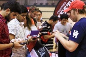Students get prizes from Frontier Fiesta Director of Devlopment Robert Spencer (right). | Catherine Lara/The Cougar