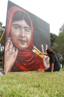 Artist Anat Ronen puts her final touches to her artwork of Malala. | Photo by Leen Basharat