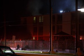 Firefighters go into the senior citizen complex to get as many people to safety on Sunday, at approximately 3 a.m. | Justin Tijerina/ The Cougar