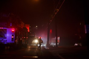 Firefighter brings in lights in hopes to clear the pathway for residents and other fellow firefighters. | Justin Tijerina/ The Cougar
