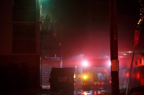 Firefighters arrive at the scene early Sunday morning.   Justin Tijerina/ The Cougar