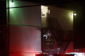 Firefighters search all floors to get residents to safety.   Justin Tijerina/ The Cougar