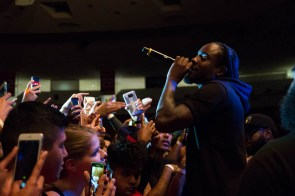 Wale embraces the crowd. | Brittaney Penney/The Cougar
