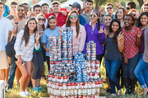 Kappa Sigma and Zeta Phi Beta showed their school spirit by building a huge Cougar sign out of cans. | Photo by Justin Cross.