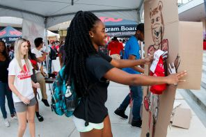 Nutrition major Stephanie Achonye and others played pin the Cougar paw on a Cougar. | Photo by Justin Cross.