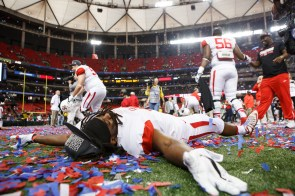 Senior safety Trevon Stewart makes confetti angels after the game. | Justin Tijerina/The Cougar