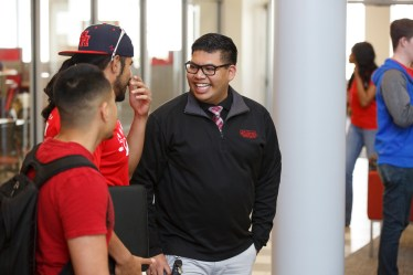 Hype Party's Edwin Mascorro with vice presdiential candidate Omar Coronado. | Justin Tijerina/The Cougar
