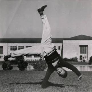 Cheerleader midway through a cartwheel in 1969.  Courtesy of UH