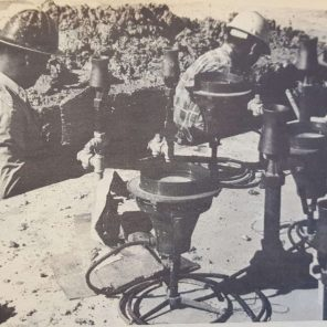 """""""If you think these workmen are looking for a dime lost when the Quadrangle Fountain was laid, you're wrong."""" Liborio Amador and Sergie Arrila were seeking a leaky water pipe Monday, which developed under the fountain. 