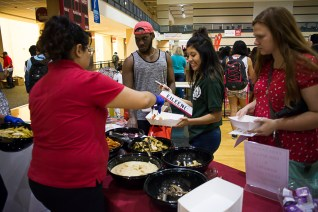 Psychology senior Eileen Gonzalez arrived early enough to enjoy free food and free UH swag at Cat's Back. | Justin Cross/The Cougar